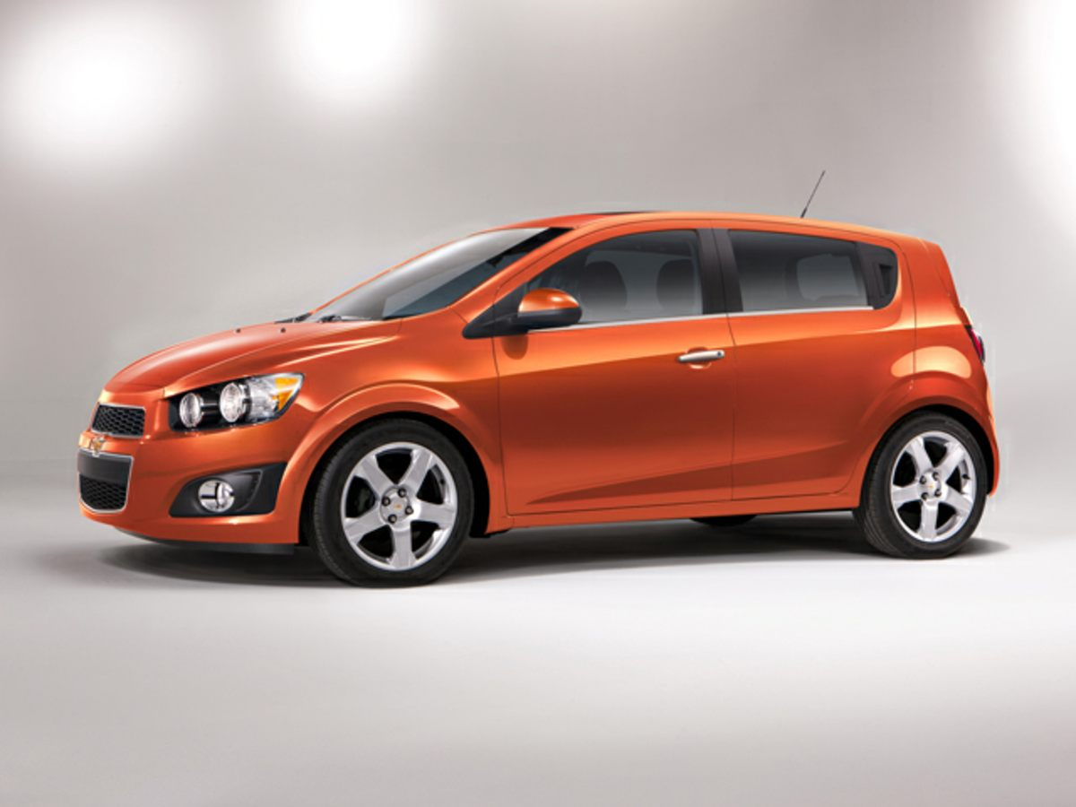 Chevrolet Sonic Owners Manual: Rear Window and Outside Mirror Defogger